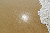 Sun reflection in sand on beach | Stock Foto