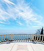 View to the sea from a balcony under cloudy sky | Stock Foto