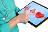 ID 3553326 | Heartbeat symbol on touchpad | Foto stockowe wysokiej rozdzielczości | KLIPARTO