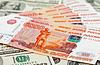 Russische Rubel Rechnungen Verlegung auf Dollar Hintergrund | Stock Foto