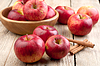 Red apples in a wooden bowl on the table | Stock Foto