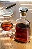 Butelka i kieliszek koniaku i cygar | Stock Foto