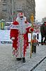 KIEW - 23. Dezember: Weihnachtsmann mit weißem Bart begrüßt | Stock Foto