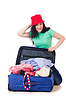 Young girl packing for vacation | Stock Foto