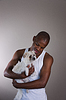 Little white dog with its African owner | Stock Foto