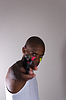 African man in facepaint pointing gun | Stock Foto