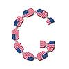 Buchstabe G aus USA-Flaggen in Form von Süßigkeiten