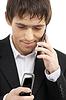 ID 3616451 | Бизнесмен с двумя сотовыми телефонами | Фото большого размера | CLIPARTO