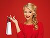 ID 3650795 | Schöne Frau im roten Kleid mit Einkaufstasche | Foto mit hoher Auflösung | CLIPARTO