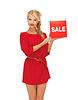 Schöne Frau im roten Kleid mit Verkauf Zeichen | Stock Foto