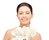 Schöne Frau mit Orchideenblüte | Stock Foto