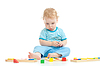 Serious pensive child playing logical education toys | Stock Foto