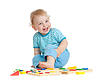 Adorable happy child playing educational toys | Stock Foto