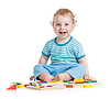 Happy child playing educational toys | Stock Foto