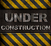 Under construction metall text mit Nieten über | Stock Photo