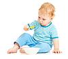 Dziecko lub jedzenia dziecko z płyty z łyżką | Stock Foto