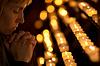 ID 3657639 | Woman praying in Catholic church | Foto stockowe wysokiej rozdzielczości | KLIPARTO