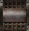 Aged metal plate on wooden medieval background | Stock Foto