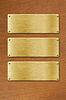 ID 3658402 | Drei goldene Metallplatten über Holzstruktur | Foto mit hoher Auflösung | CLIPARTO