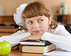 Schoolgirl`s portrait at school desk with her books | Stock Foto