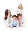 Glückliche Familie auf dem Boden liegend im Studio | Stock Photo