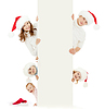 Glückliche Familie in Christmas Santa `s Hut: 2 Eltern, | Stock Photo