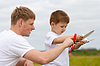 ID 3660478 | Father and son have fun with toy aircraft model in | Foto stockowe wysokiej rozdzielczości | KLIPARTO
