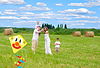 Happy family with pregnant wife fly kite together i | Stock Foto