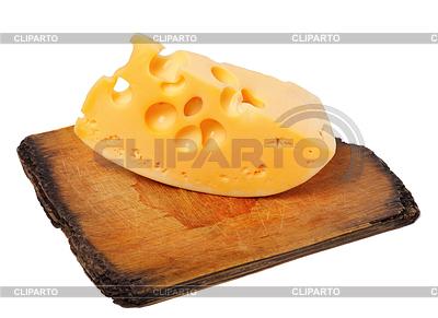 Stück Käse auf alten Holzbrett | Foto mit hoher Auflösung |ID 3574761