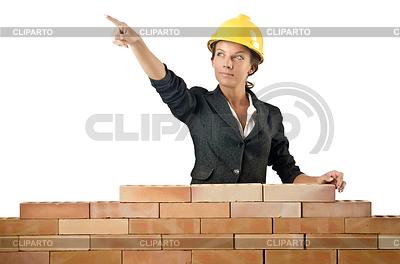 Junge weibliche Builder Nähe Ziegelmauer | Foto mit hoher Auflösung |ID 3443909