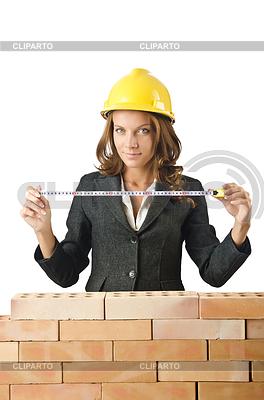Woman Architekten in der Nähe Ziegelmauer | Foto mit hoher Auflösung |ID 3471622