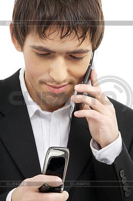 Бизнесмен с двумя сотовыми телефонами | Фото большого размера |ID 3616451