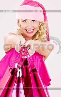 Fröhlichen Santa Helfer Mädchen mit Einkaufstüten | Foto mit hoher Auflösung |ID 3618068