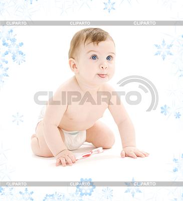Baby boy in diaper with toothbrush sticking tongue | Foto stockowe wysokiej rozdzielczości |ID 3619029