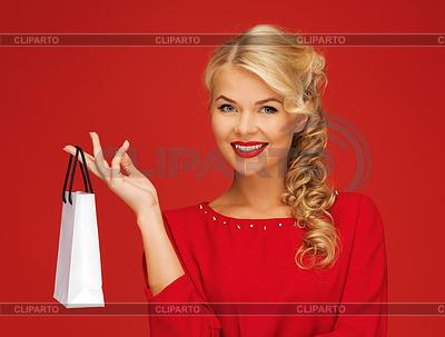 Schöne Frau im roten Kleid mit Einkaufstasche | Foto mit hoher Auflösung |ID 3650795