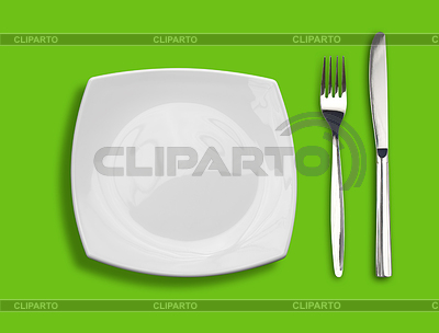 Knife, square white plate and fork on green | Foto stockowe wysokiej rozdzielczości |ID 3657548