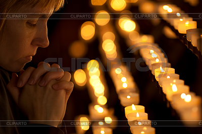 Woman praying in Catholic church | Foto stockowe wysokiej rozdzielczości |ID 3657639