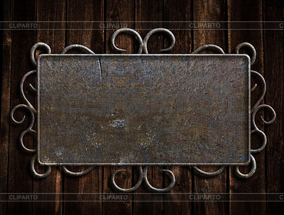 Vintage metalowa płyta na starym drzwi dębowe | Foto stockowe wysokiej rozdzielczości |ID 3658313