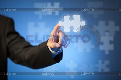 Strony dotykając abstrakcyjny kawałek układanki biznesmen `s | Foto stockowe wysokiej rozdzielczości |ID 3659666