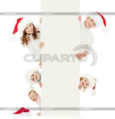 Glückliche Familie in Christmas Santa `s Hut: 2 Eltern, | Foto mit hoher Auflösung |ID 3660320